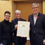 Photo of councillor Catherine McKenney, Board Chair René Rivard, Mayor Jim Watson, with 30th anniversary certificate